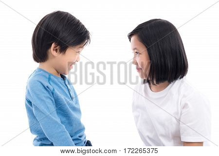Cute asian children make eye contact on white background isolated
