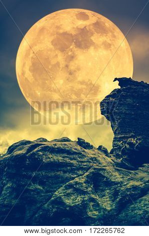 Boulder Against Sky With Clouds And Beautiful Full Moon At Night. Outdoors. Sepia Tone.