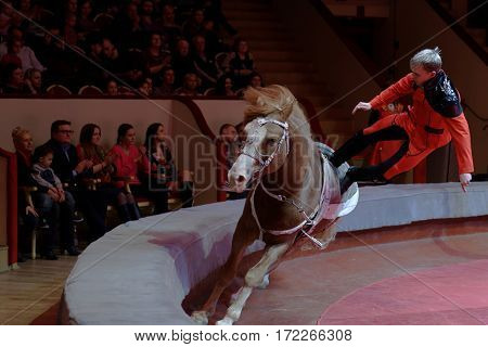 ST. PETERSBURG, RUSSIA - FEBRUARY 3, 2017: Vaulting on horseback during dress rehearsal of the circus program CircUS 2.0. The program reflects the vision of circus art of XXI century