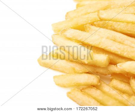 Pile of a potato french fries, close-up crop composition isolated over the white background
