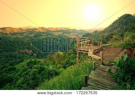 Old wood balcony terrace with mountain view in the morning during sunrise at Baan Ja Bo , Mae Hong Son, Thailand
