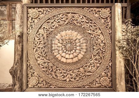 Carved wood decoration in Thailand. Sepia tone