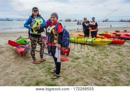 Labuan,Malaysia-Feb 19,2017:Group of adventurer ready to kayaking in Labuan island,Malaysia.Malaysia is the ideal place for water sports,like white water rafting,kayaking,scuba diving,sailing,banana boating,jet skiing,wakeboarding or parasailing, Malaysia