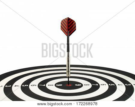 dart arrow hitting in the target center of dartboard, aim goal and achievement