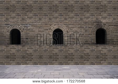 Picture of three hole on the brick wall at the Great Wall of China in Beijing China