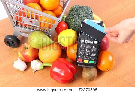 Payment Terminal With Contactless Credit Card And Fruits And Vegetables, Cashless Paying For Shoppin