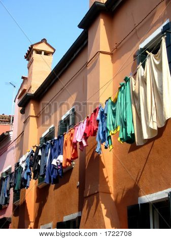 Venice Colourful Clothes Outside Houses On Burano Island, Italy