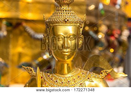 Theppaksi Gold Statue. Asian Art Close Up