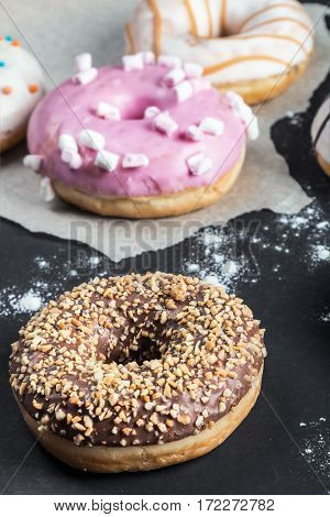 glazed donuts with different fillings on a black background