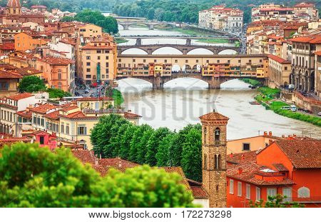 River Arno Florence with bridge Ponte Vecchio and roofs of old town