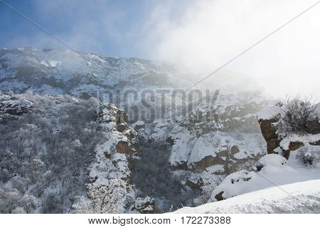 A winter panorama of Geghard Monastery unique architectural construction and a UNESCO World Heritage in Armenia.