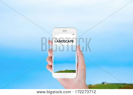 woman using her smartphone for searching the travel information of beautiful landscape. Traveling concept Beautiful blurry landscape background.