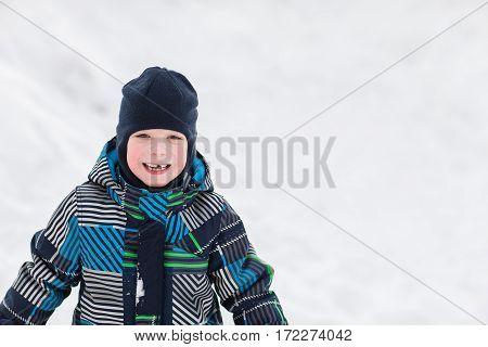 Portrait of little boy in winter time.