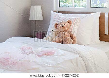 White Bedroom Decorative With Pillows And Dolls On Bed