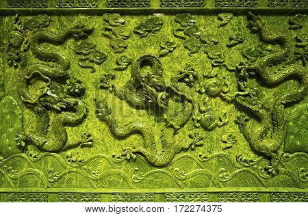 Image of green Chinese stone dragon in the Forbidden City in Beijing China