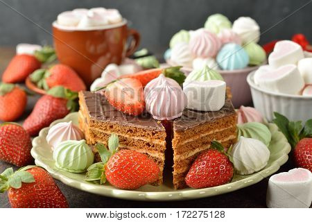 Various festive sweets on brown background close up