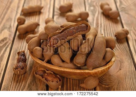 Exotic fruit tamarind on a brown background