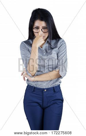 Portrait of female entrepreneur thinking solution while touching her forehead isolated on white background
