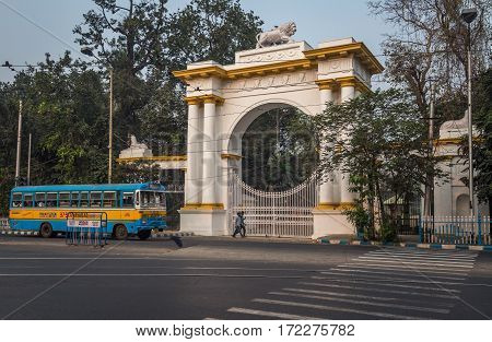 KOLKATA, INDIA -FEBRUARY 12, 2017: A public transport bus crosses the entrance of the Gothic architectural Governor house near Dharmatala Chowringhee area in Kolkata.
