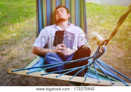 Blur sleeping man in the hammock as a background