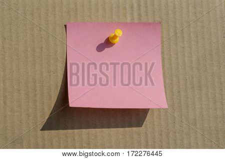 pink note on paper background with shadow