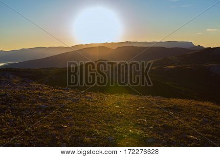 Sunrise over the mountains of the Southern Crimea. View from the top of the mountain Ilyas Kaya.