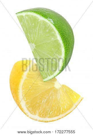 hanging falling flying cutting piece of lemon and lime fruits isolated on white background with clipping path