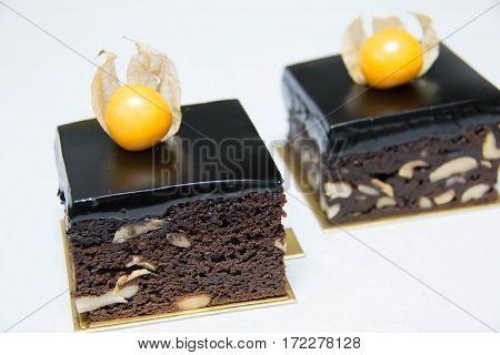 Freshly baked chocolate fudge brownies with a chocolate ganache