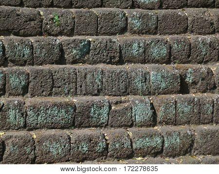 Texture of ancient rough cobblestone stair lead up to the Khmer Temple in Phanom Rung Historical Park, Thailand