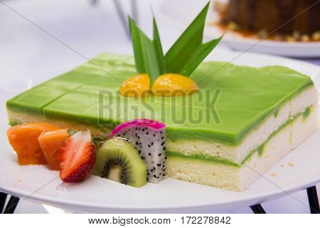 Sponge Cake Layered in Rich Pandan Kaya. With a grated coconut for the finishing.