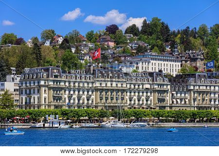 Lucerne, Switzerland - 8 May, 2016: people and buildings on Nationalquai quay, view from Bahnhofquai quay. Lucerne is a city in central Switzerland, it is the capital of the Swiss canton of Lucerne and the capital of the district of the same name.