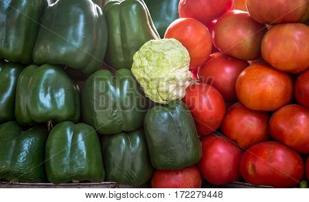 Green capsicum and tomato stacked together for background content