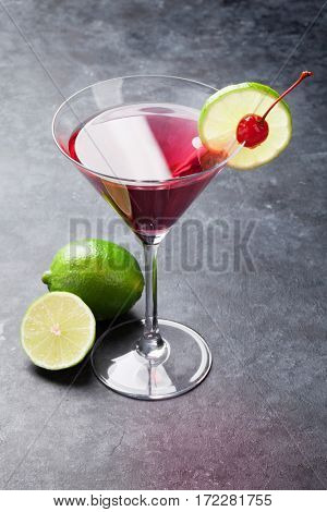 Cosmopolitan cocktail on dark stone table