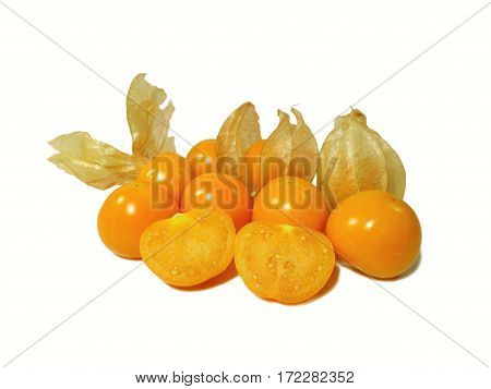 Bunch of bright orange yellow ripe Cape gooseberries, some with calyx, some cut in half isolated on white background