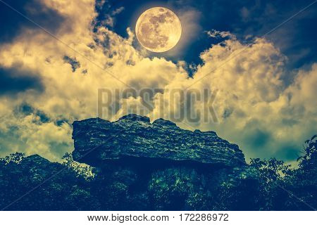 Boulder Against Sky With Clouds And Beautiful Full Moon. Outdoors.
