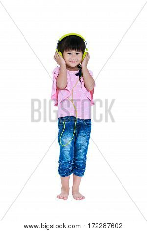 Full body of happy asian child relaxing with headphones. Isolated on white background. Smiling girl listening and enjoying music using earphone. Studio shot. Technology and music concept