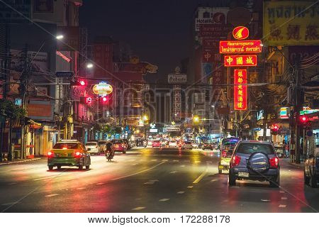 Bangkok, Thailand - December 26th 2016: Night Picture of Yaowarat Road in Samphanthawong district which is the Main Street in Bangkok's Chinatown with its Busy Traffic, Neon Signs, Restaurants and Street Food Stalls.