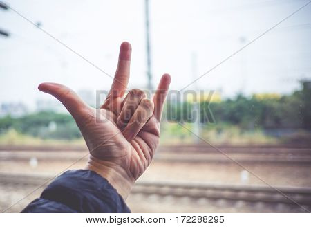 Love Hand Sign With Blurred Train Track At Background,love Travel Concept
