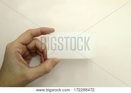Hand holding a business card. Isolated image.