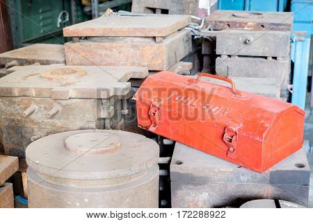 Grunge Red Metal Tool Box On Rustic Moles In Factory