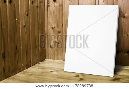 Blank White Poster Leaning At Wooden Wall In Plank Wood Room,mock Up For Adding Your Content.