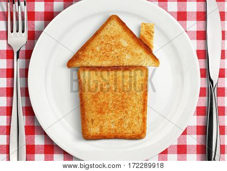 Table setting with house on plate .