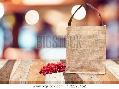 Brown shopping sack bag and cherry fruit on wooden tablemock up for adding your text.
