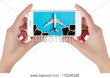 Woman hand using smart phone searching Preparation for Traveling with Blank photograph. Travel concepts Isolated on white background.
