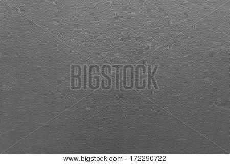 the abstract textured background of old leather or synthetic fabric of gray color