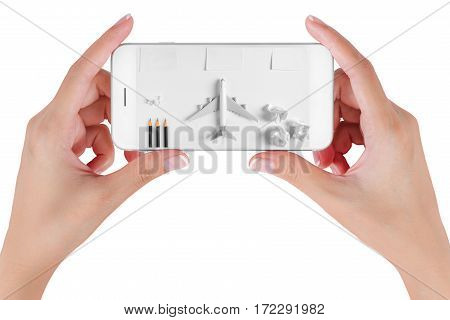 Woman hand using smart phone searching Preparation traveling with blank paper noted paper ball airplane push pin pencils. Travel concepts and to do list Isolated on white background.