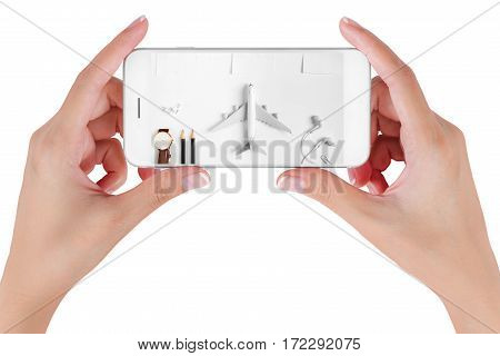 Woman hand using smart phone searching Preparation traveling with push pin pencil watch money dollar string paper noted. Travel concepts Isolated on white background.