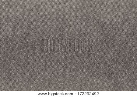 abstract background and speckled or mottled texture of fabric or textile material of pale brown color