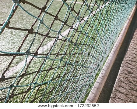 Outdoor sport court behind rope mesh in moring light, Color retro image for background