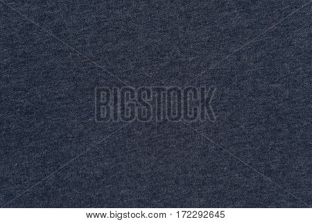 abstract background and texture of jersey or knitted textile fabric of dark blue color